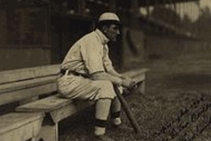 Nap Lajoie sitting on the bench
